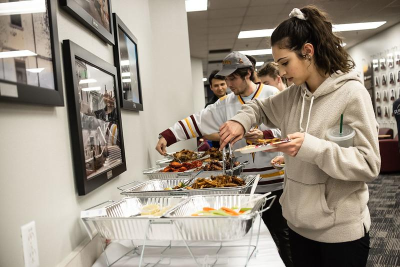 Students getting food at event