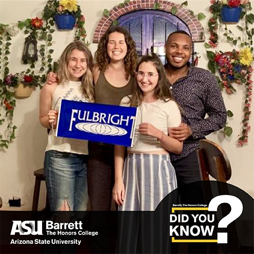 Students holding a sign with the Fulbright logo