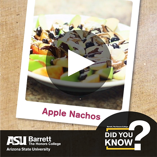 Apple slices drizzled in chocolate with video player button overlay