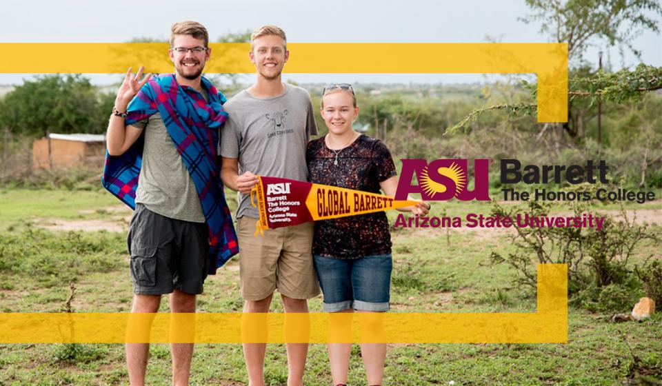 Barrett students posing in Africa with a Barrett pennant
